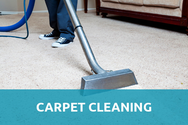 "Man wearing a jeans with black and white shoes standing on a white carpet and is holding a steam carpet cleaner with a header title that says ""Carpet Cleaning"" with blue background and that is one of the services of carpet cleaning Albuquerque."