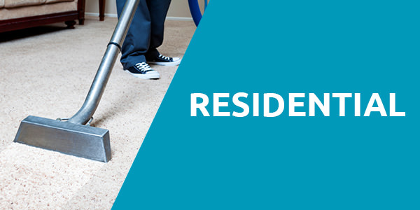 "Man wearing a jeans with black and white shoes standing on a white carpet and is holding a steam carpet cleaner with a header title that says ""Residential"" with blue background and that is one of the services of carpet cleaning Albuquerque."