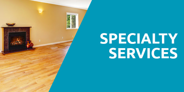 "A chimney placed on a yellow wall with the light bulb, window and a wooden floor with a header title that says ""Specialty Services"" with blue background and that is one of the services of carpet cleaning Albuquerque."
